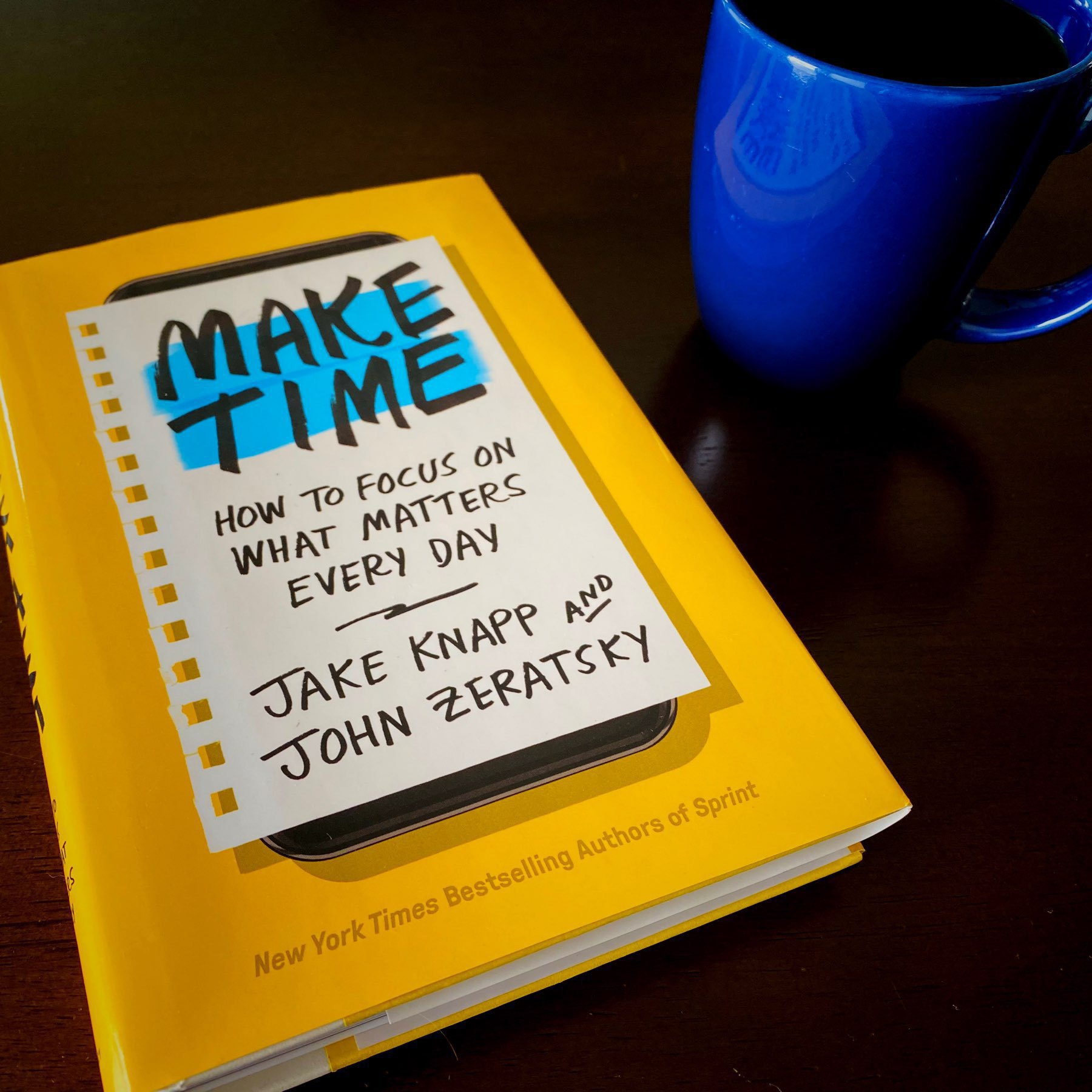 Make Time book sitting on a table next to a coffee mug