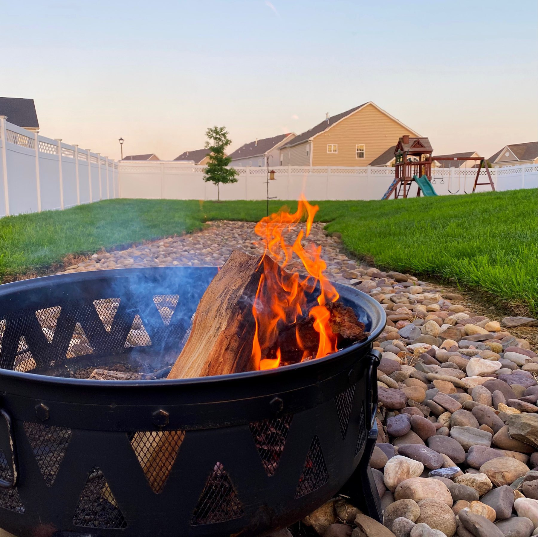 burning wood in a fire pit on stones