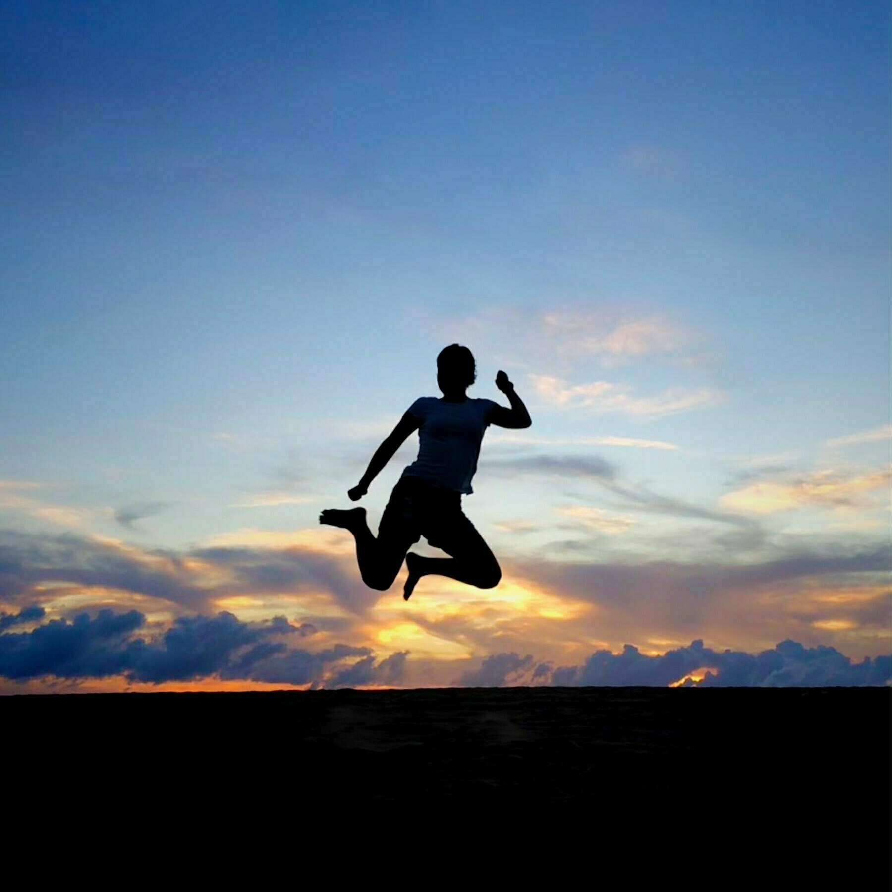 jumping with a sunset in the background
