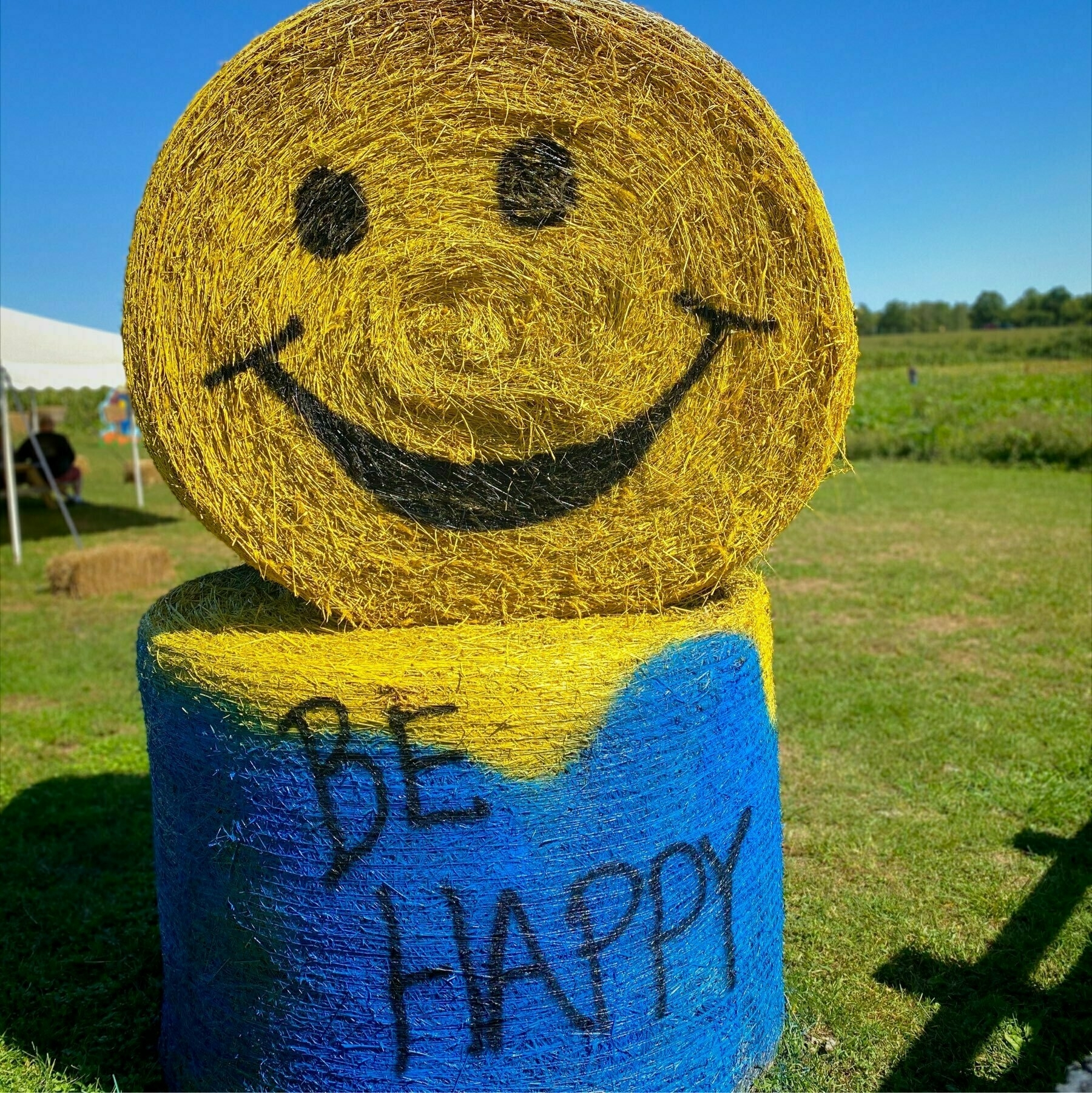 """hay bale with the words """"be happy"""" on it"""