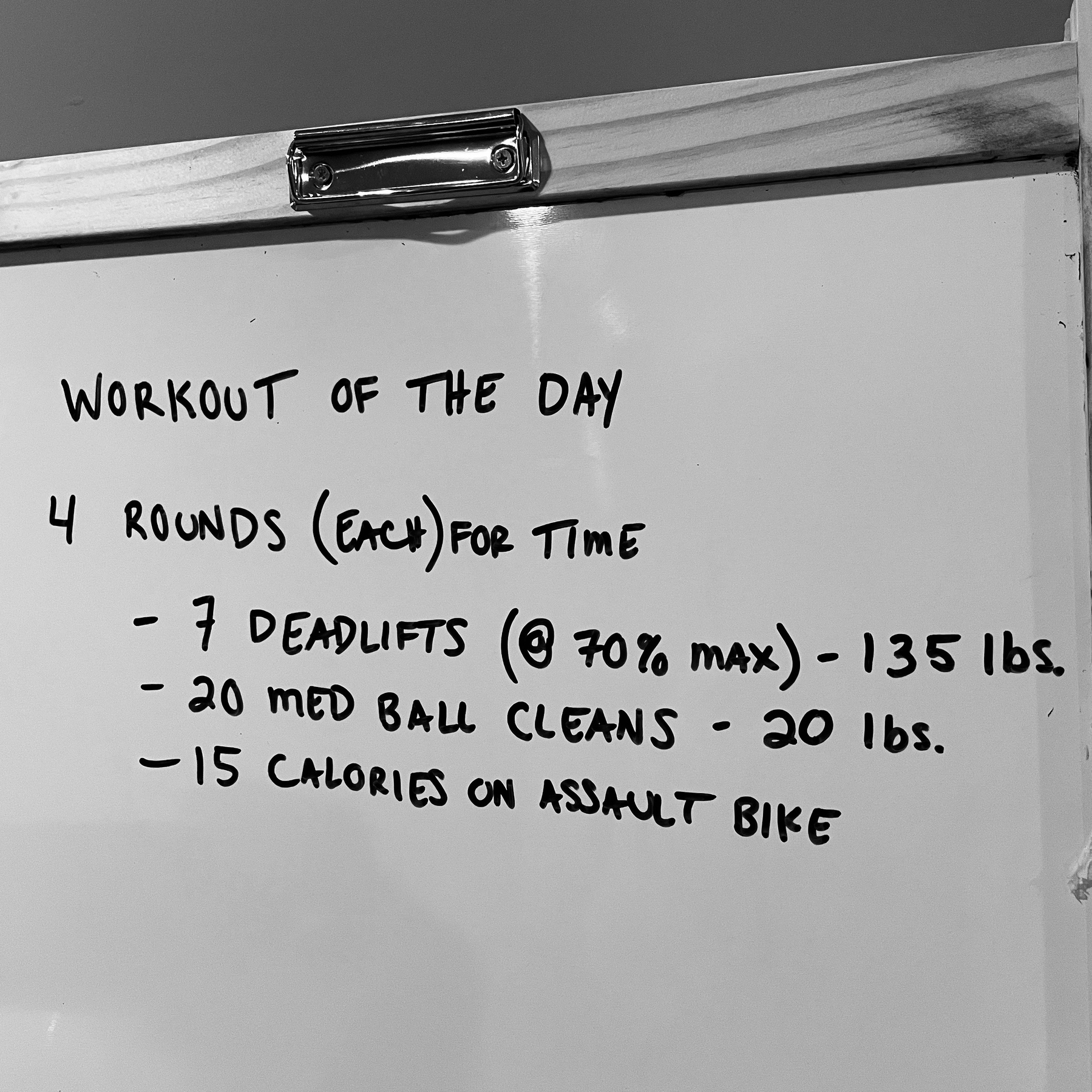 whiteboard with workout written on it